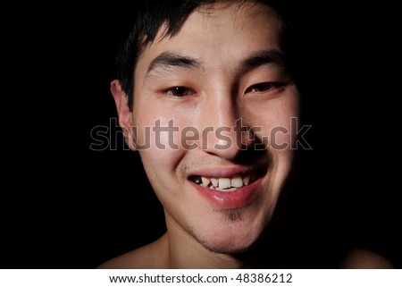The obverse portrait of the young Asian man which smiles - stock photo