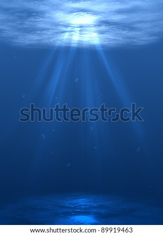 the ocean floor with bubbles of air and bright sunlight - stock photo