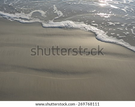 The Ocean Meeting the Sandy Beach - stock photo