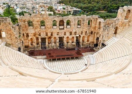 The Odeon of Herodes Atticus , om Acropolis slope, was built it in 161 AD in memory of his wife, Aspasia Annia Regilla - stock photo