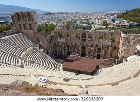 The Odeon of Herodes Atticus with the city of athens is in the background. - stock photo
