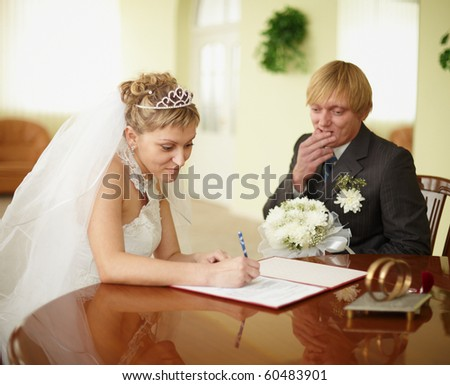 The official registration of marriage. Groom in doubt. - stock photo