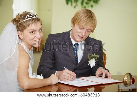The official registration of marriage. Happy newlyweds. - stock photo