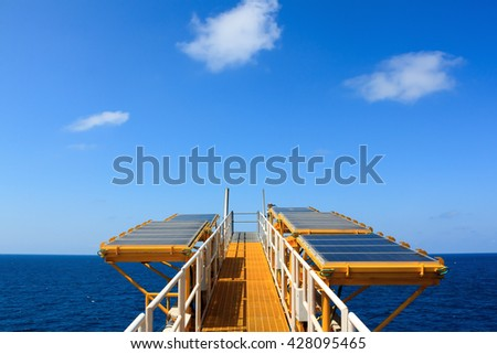 the offshore industrial equipment Solar cell or solar panel on offshore platform with blue sky by industrial concept or offshore equipment concept. - stock photo