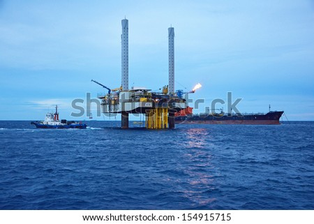 The offshore oil rig in early morning, Gulf of Thailand.  - stock photo