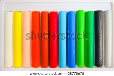 The oil pastels in package, selective focus. - stock photo