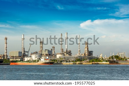 The oil refinery at riverside in day time - stock photo