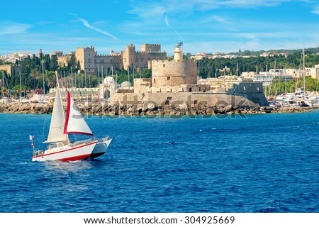 The old Agios Nikolaos fortress and the Palace of the Grand Masters. Rhodes town, Rhodes, Dodecanese, Greek Islands, Greece - stock photo