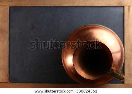 The old and dirty copper jug represent the containing equipment concept related idea.