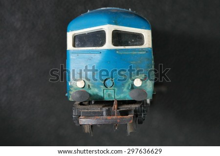 The old and dirty plastic model of train represent the model train concept related idea.  - stock photo