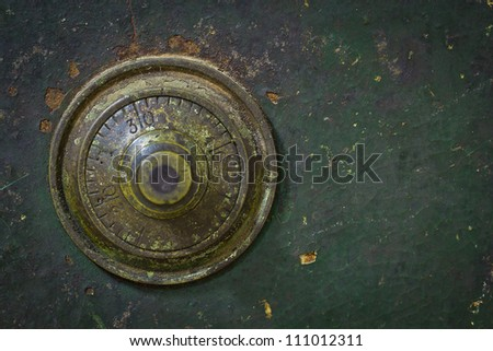 the old and grunge vintage dial key lock safe - stock photo