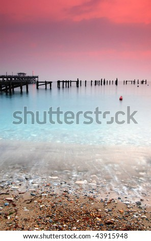 The old and new Swanage Piers at sunrise - Dorset, UK - stock photo