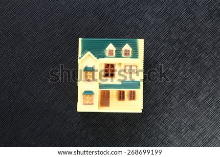 The old and vintage rural style of miniature plastic house model represent the mortgage concept related idea. - stock photo