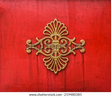 The old art of Oriental Chinese design on red concrete wall for interior and exterior - stock photo
