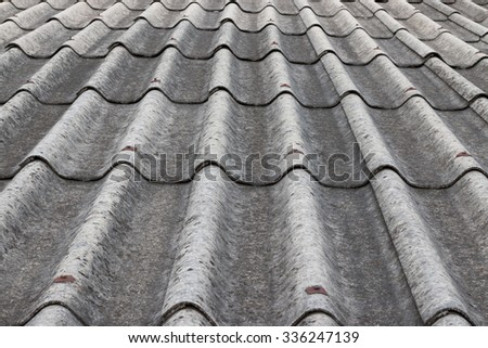 The old asbestos roofing material - stock photo