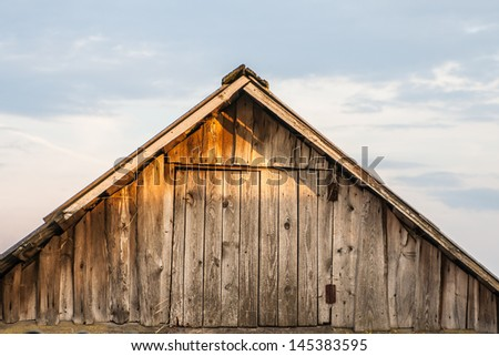 The old barn roof against the sky - stock photo