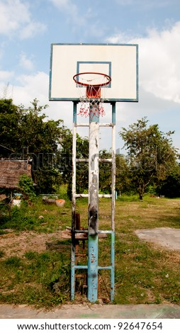 The Old basketball court on blue sky background - stock photo