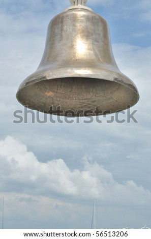 The old bell in the background of the sky - stock photo