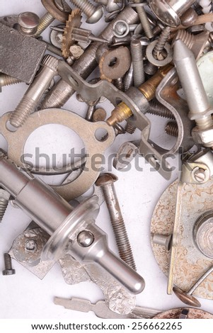 the old bolts, screws and metal details close up - stock photo