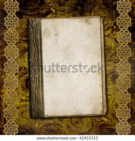 The old book on the floral background.