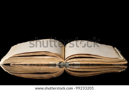 The old books on a black background - stock photo
