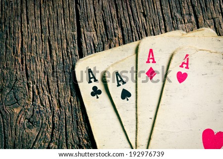 the old cards on wooden table - stock photo