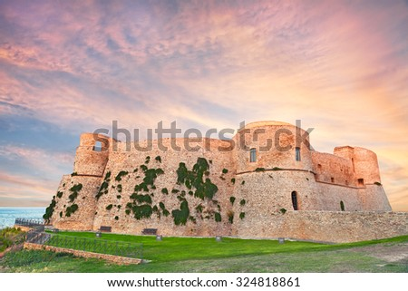 the old castle (Castello Aragonese) overlooking the sea at sunset in Ortona, Abruzzo, Italy