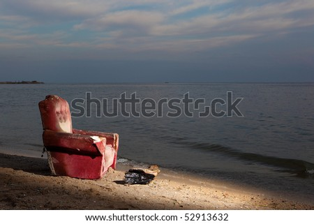 the old chair on the beach - stock photo