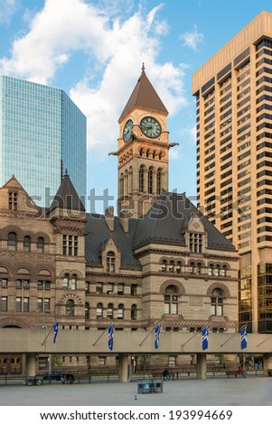 The Old City Hall in downtown Toronto. Tourist landmark and a National Historic Site of Canada. It is one of the city's most prominent structures. Featuring tower with clock - stock photo
