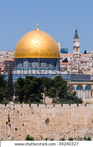 The Old City of Jerusalem, including the Dome of the Rock and church steeples. - stock photo