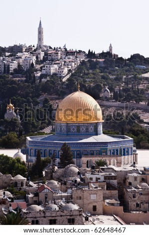 The Old City of Jerusalem, punctuated by the Dome of the Rock, with the Mount of Olives in the background. - stock photo
