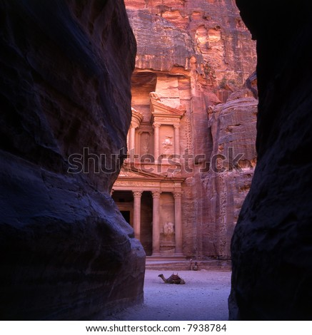 The old city of Petra in Jordan was carved out the rocks. It is now an UNESCO World Heritage site. - stock photo