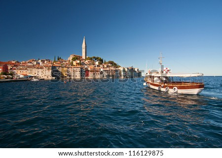 the old city Rovinj with boat - Croatia - stock photo