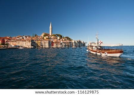 the old city Rovinj with boat - Croatia - stock photo