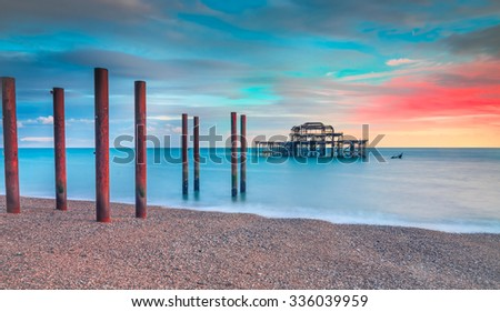 The old derelict West Pier in Brighton during a beautiful sunset - stock photo
