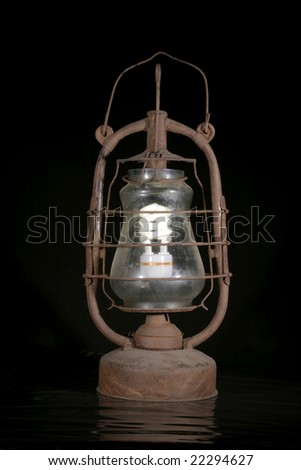 the old dirty kerosene lamp with modern electric bulb