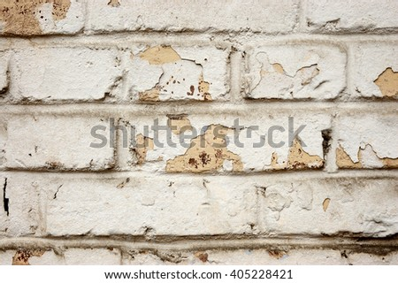 the old dirty painted brick wall close up - stock photo