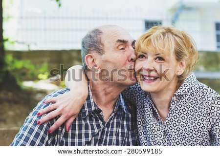 The old father loves his daughter  - stock photo