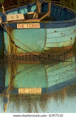 the old ferry boat on the Burham Deepdale Marshes - stock photo