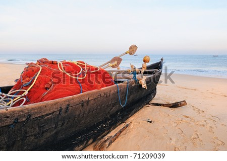 The old fishing boat on the sandy shore. In Goa - stock photo