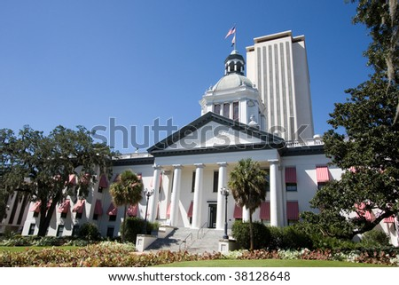 The old Florida State Capital building, now a museum, stands in front of the new capital offices in Tallahassee, Florida. - stock photo