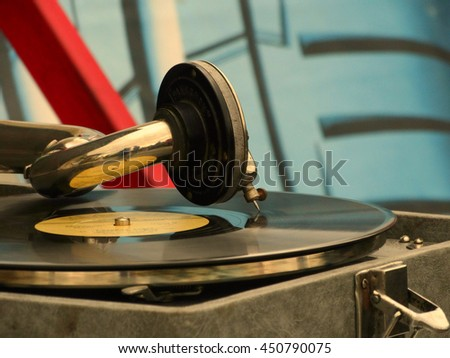 The old gramophone on the table vintage retro rarity style 30s 40s 50s 60s closeup vinyl needle song music time melody generation sound