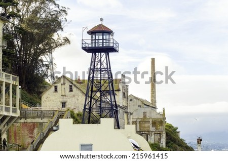 The old Guard Tower on Alcatraz Penitentiary island, now a museum, in San Francisco, California, USA. A view of the watchtower and the power house. - stock photo