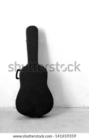 The Old Guitar case in black and white - stock photo