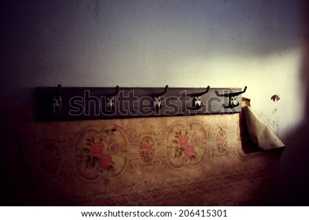 the old hanger and rubbed from time is beaten to a wall - stock photo
