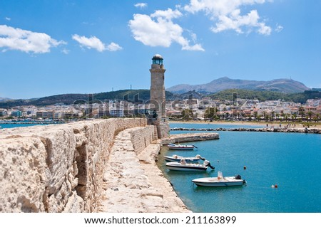 The old harbour with the lighthouse. Rethymno city, The Crete island,Greece. - stock photo