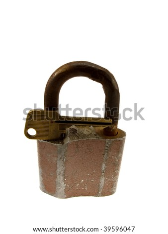The old hinged lock with a key isolated on a white background