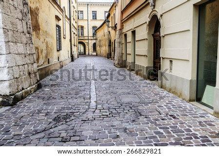The old historic streets of Krakow in Poland. - stock photo