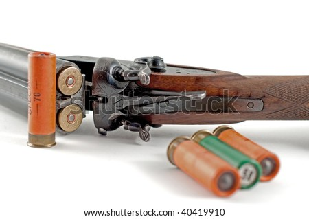 The old hunting rifle and bullets - stock photo