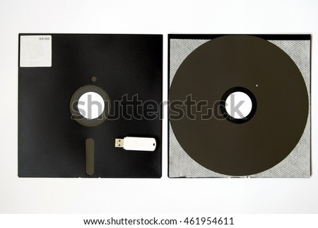 The old 8-inch floppy disk, insides, a comparison with the flash drive